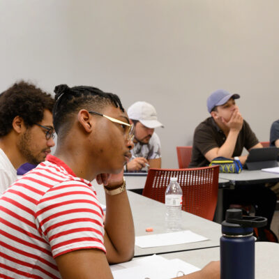 A multi-ethnic group of students works in Professor Uri Treisman's freshman calculus class.